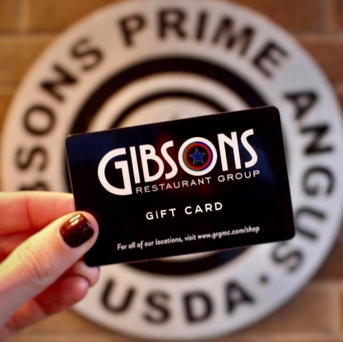 Image of a hand holding a Gibsons gift card